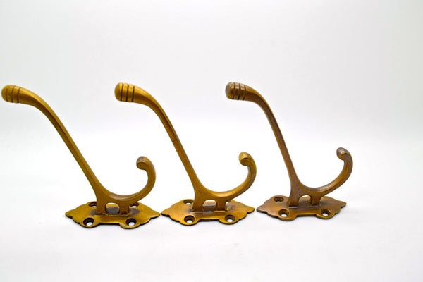 Brass wall and door hooks. Classic victorian design. Supplied with fitting screws.