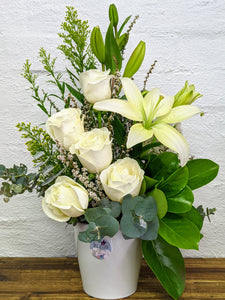 arrangement of white asiatic lilies and white  roses