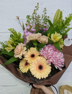 seasonal flowers arranged in a bouquet styled by our talented florists
