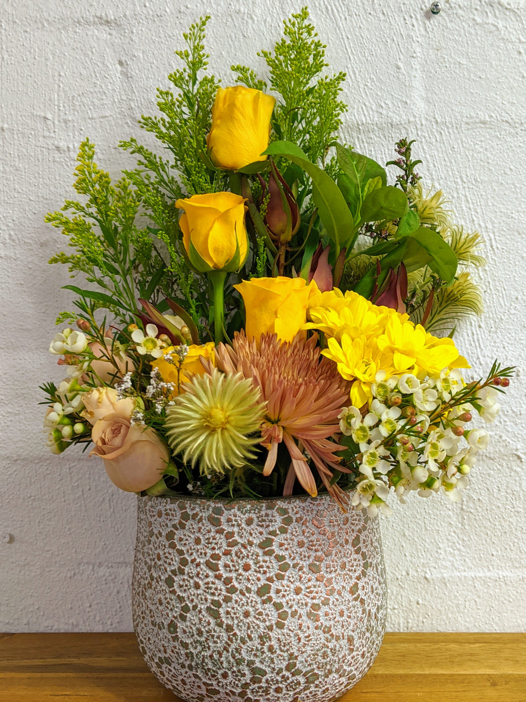 ceramic vase with yellow rose, chrysanthemums and greenry