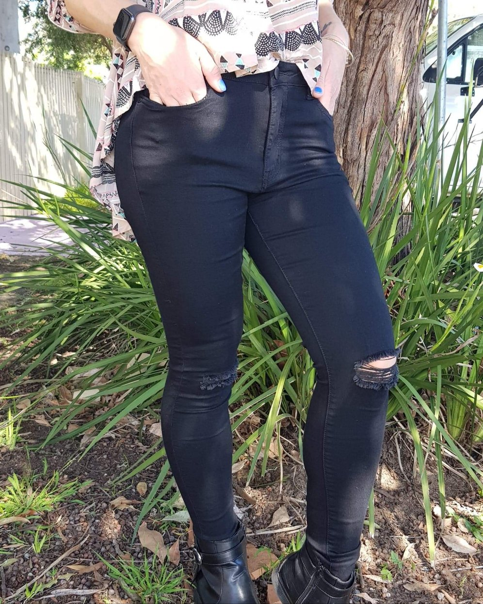 Black ripped knee jeans