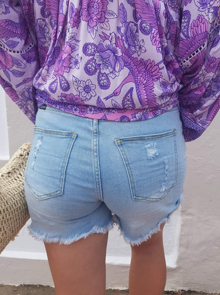 Exposed button ripped shorts