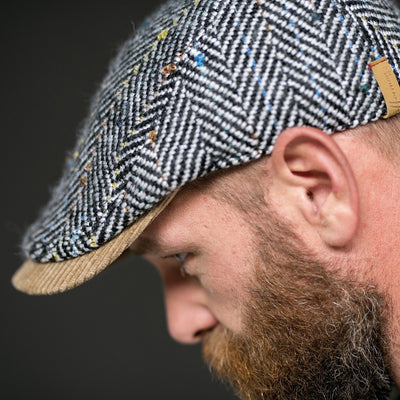 PUffin (c) Seasoned tweed flat cap