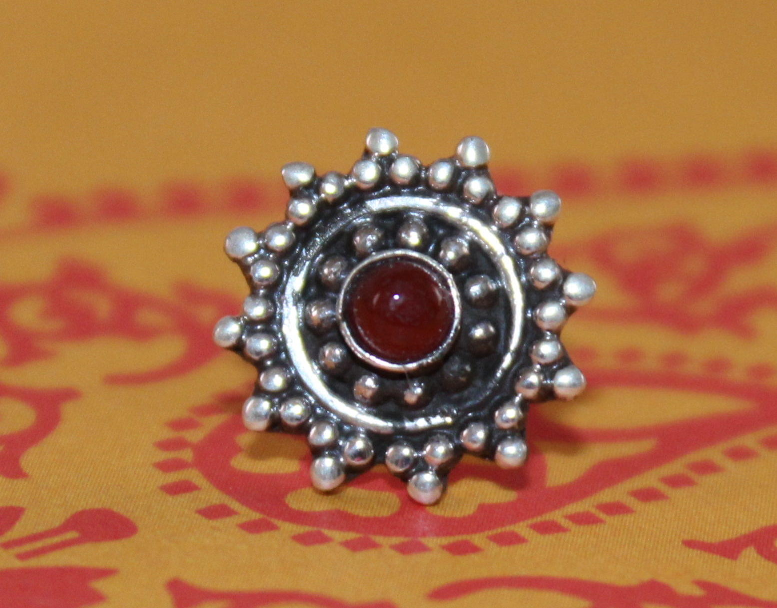 Flower with Red Stud Nose Pin