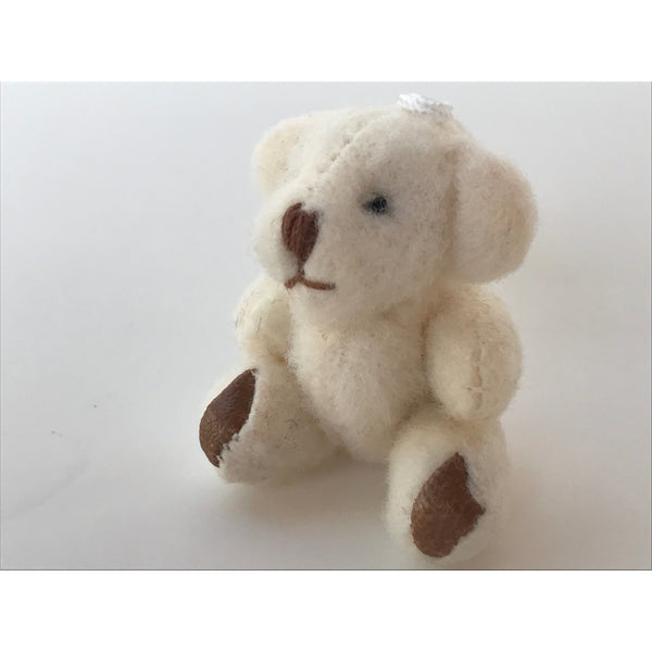 stuffed small stuffed bear white