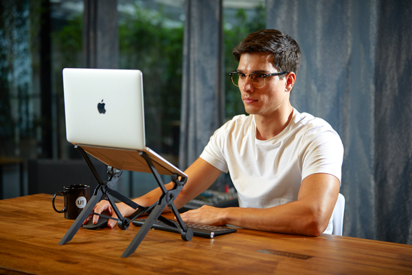 Man using a laptop stand