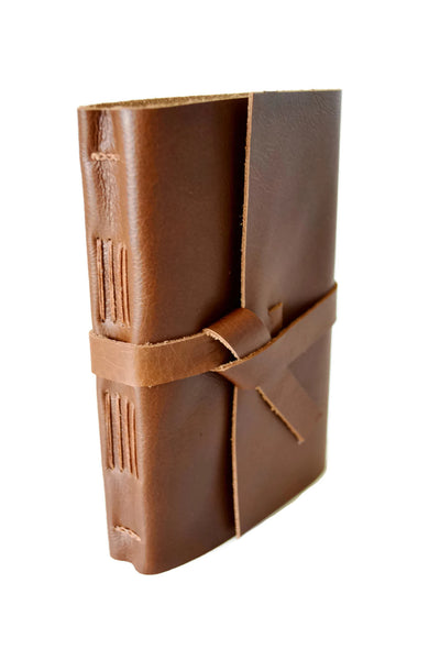 Front angled view of golden brown genuine leather sketchbook
