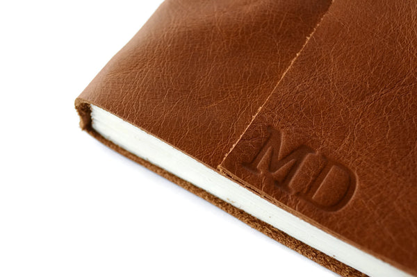 Example of stamped personalized initials on Golden Brown leather journal cover