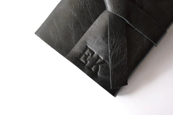 Example of stamped personalized initials on Black leather journal cover