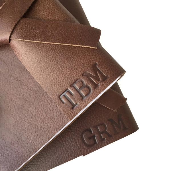 Example of stamped personalized initials on Chocolate leather journal covers