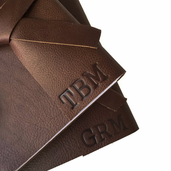 Example of stamped personalized initials on Chocolate leather journal cover
