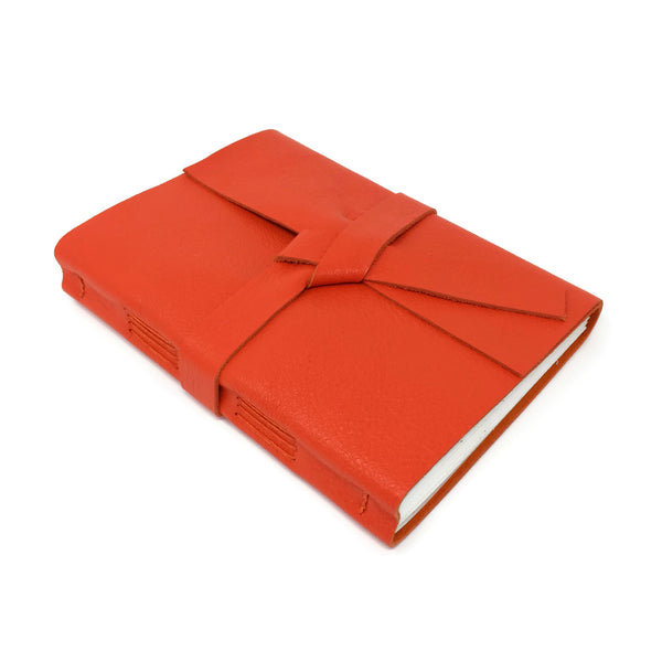 Top angled view of orange leather sketchbook