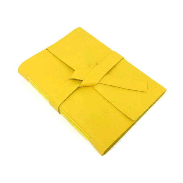 Top view of yellow leather journal notebook