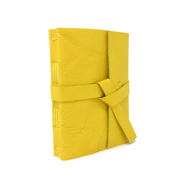 Angled front view of yellow leather journal notebook