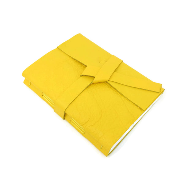 Top angle of yellow leather journal