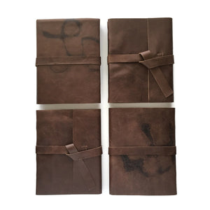 4 Examples of Chocolate Brown Journals with Extra Character Leather Covers
