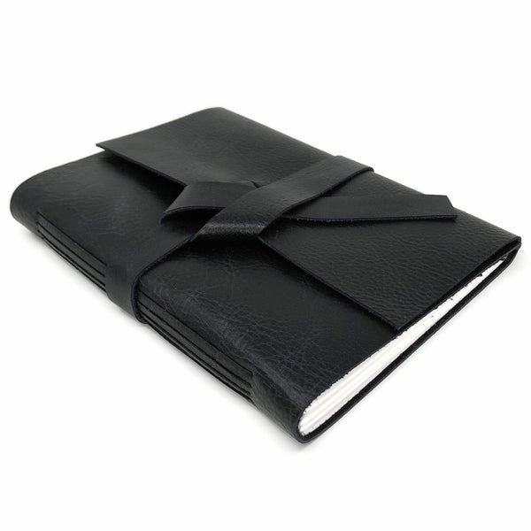 Top angle of black leather slim notebook