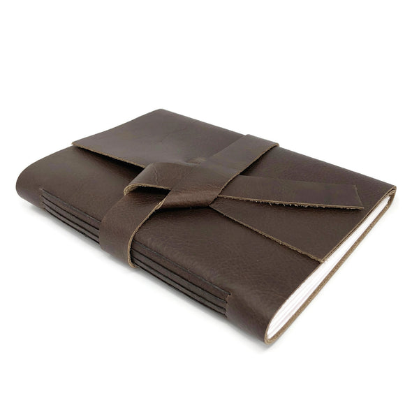 Top angled view of slim leather journal notebook in chocolate brown