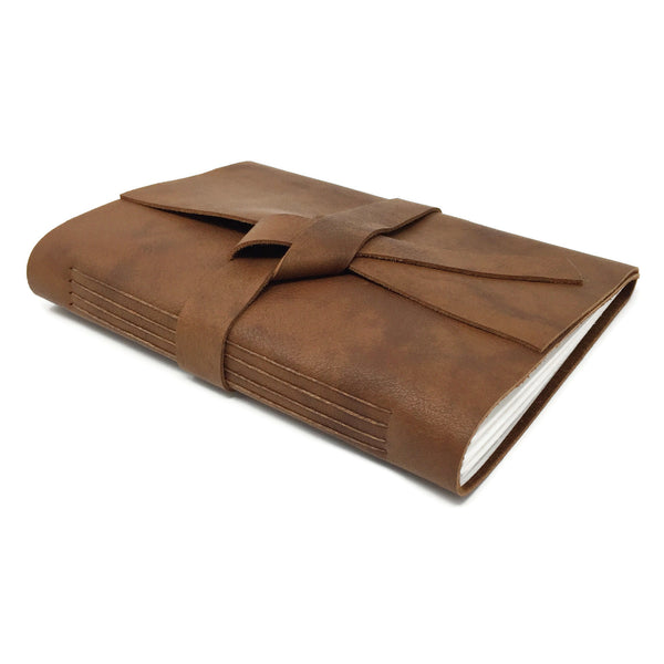 Top angle of cognac leather slim journal