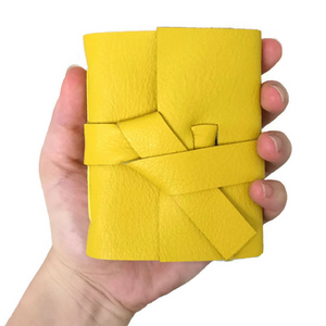 Mini Yellow Leather Notebook in someones hand
