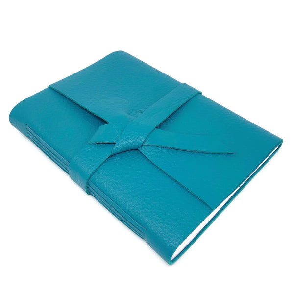 Top angle view of teal blue leather travel journal