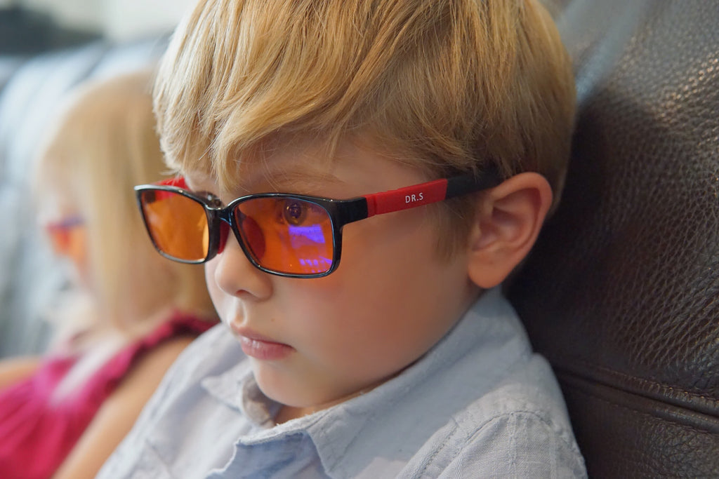 Up Close of a Boy Wearing Blue Light Blocking Glasses