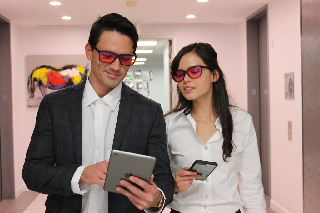 Male and Female Looking at a Tablet with Blue Blocker Glasses