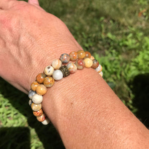 Crazy Lace Agate bracelet pair on wrist