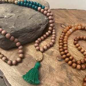 "Mala #3 - Made with brown and green dyed wood beads, Picture Jasper stones, an oval Picture Jasper guru stone, and a 1"" cotton green tassel."
