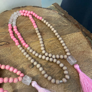 "Mala #2 - made with cream and light pink dyed wood beads, Rose Quartz beads, a barrel shaped, faceted Rose Quartz guru stone, and a 2"" silky, pink tassel."