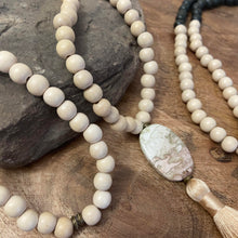 "Mala #1 - Made with cream and olive green dyed wood beads, Green Line Jasper stones, an oval Crazy Lace Agate stone, and a 2"" silky cream tassel."