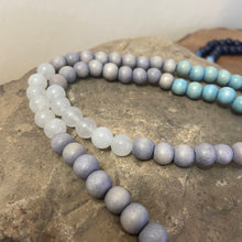 "Mala #4 - Made with light grey and light blue dyed wood beads, Snow Quartz beads, an oval Zebra Japser guru stone, and a 2"" cotton, light blue tassel with a silver accent."