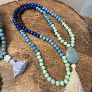 Mala #3 - blues with Amazonite guru and cream tassel.