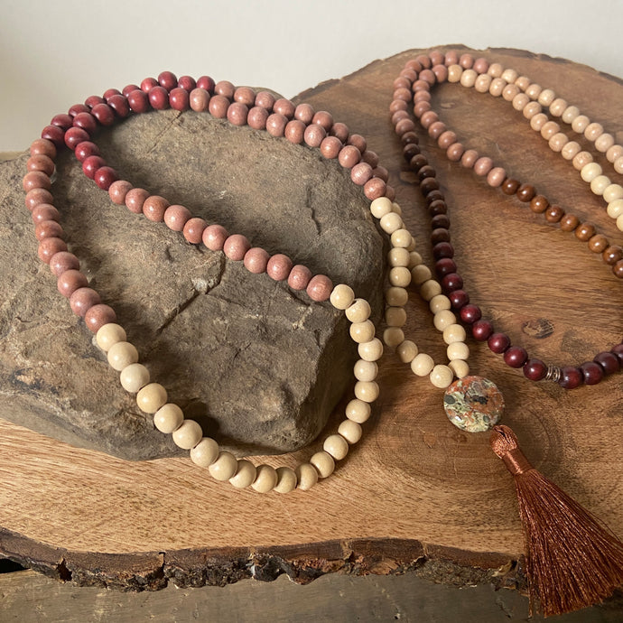 Mala #1 - Made with cream and rust colored dyed wood, along with natural wood beads and a circle shaped, Dragon Jasper guru stone. The silky tassel is 2
