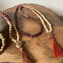 "Mala #2 - Made with natural wood beads and cream - dark brown dyed wood beads, a circle shaped, Dragon Jasper guru stone and a silky 2"", rust colored tassel."