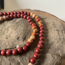 "Mala #6 - Made with natural light wood beads, rust and multi-colored dyed wood beads, an rectangle shaped, Crazy Lace Agate guru stone, and a cotton, 2"", tan colored tassel."