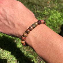 Red Creek Jasper bracelet on wrist