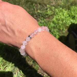 polished rose quartz bracelet on wrist