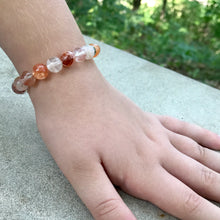 Blood Quartz 8mm bracelet on wrist