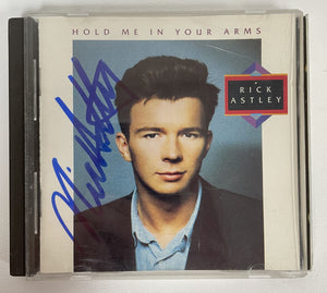 "Rick Astley Signed Autographed ""Hold Me in Your Arms"" Music CD - COA Matching Holograms"