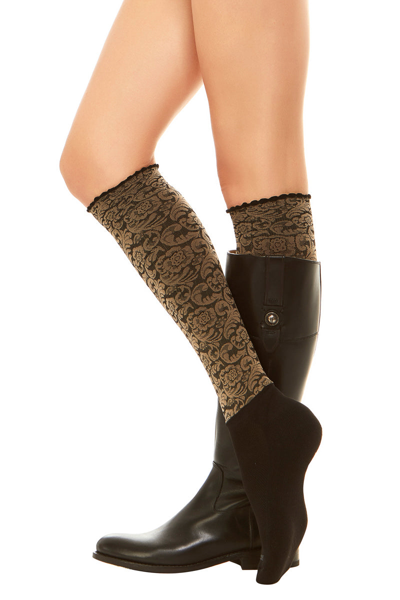 Sleek compression sock design in a floral print and attached performance athletic sock.