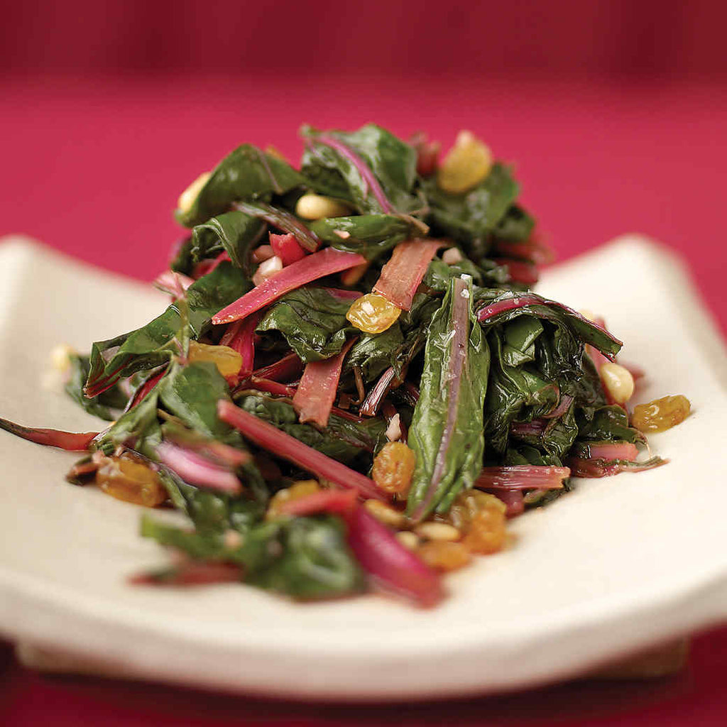 Sauteed spinach with golden raisins and toasted Pinoli pine nuts