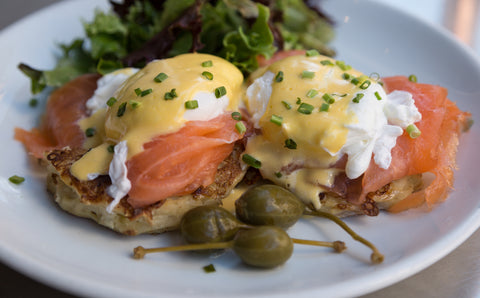 poached eggs with hollandaise and smoked salmon on crispy hash browns