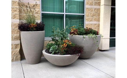 Large round outdoor concrete planters for sale available in multiple sizes