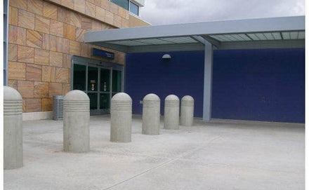 Heavy Duty concrete security bollard with three reveal lines at a drop off and pick up area