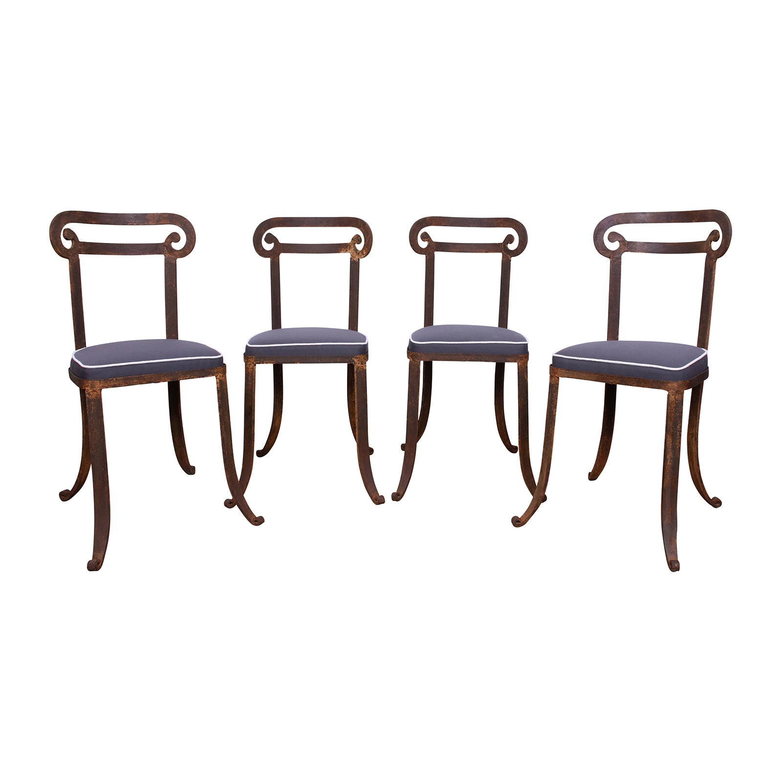 A Set of Four Klismos Style  Cast Iron Chairs