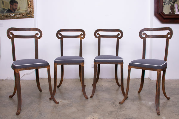 A Set of Four Klismos Style Forged Iron Chairs