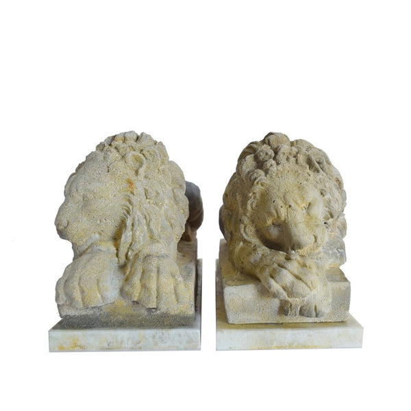 Pair of cast stone lions