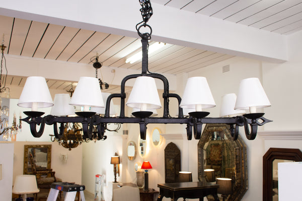 A Rustic Forged Iron antique light fixture