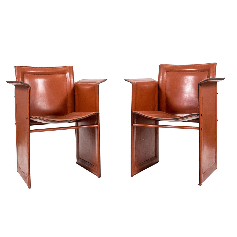 A pair of leather Korium chairs by Tito Agnoli